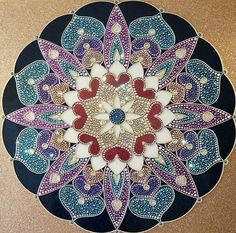 This is beaded but I think lends itself to painting on a rock, quilling or zendoodling.