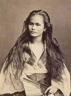 A Filipino mestiza woman poses for a portrait in 1875