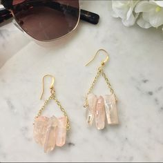 Rose Quartz Earrings Welcome the new season with these adorable spring colored earrings in rose quartz. They have flecks of gold in the stones to create a lovely shimmer. Handmade by me. Features three stones per earring. Handmade Jewelry Earrings