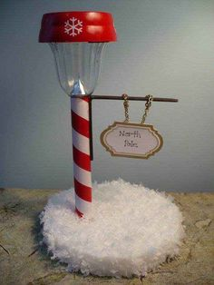 Make a tiny North Pole out of a solar stake light.