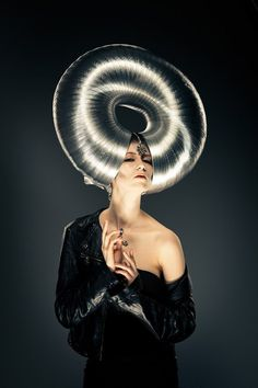 avant garde (Ear extension? Glass cones and then sculptural headpiece to hold them in place?