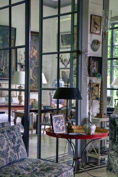Furlow Gatewood - pivoting glass-paned interior doors.