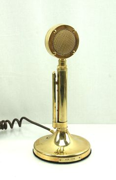 My Dad and I used to talk on the CB to truckers and he had this mic. A Vintage Golden Eagle Gold Lollipop CB Ham Radio Microphone Astatic Corp