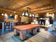 Sensational game room, complete with bar, incredible billiard table, billiard light, fireplace. The ceiling, the rug, what a work of art!