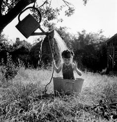 Robert Doisneau - La douche à Raizeux, 1949..... Reminds me of when I was little and played in old metal wash tubs..