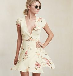 Reformation Petites Raquel Dress Mini wrap dress with a deep V neckline, gathered cap sleeves and a tie waist. It's fitted through the bodice then kicks out at the skirt. #fashion