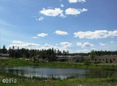 MLS# 312455 Wonderful lot sitting at the E end of pond just S of whitefish mall. perfect for a restaurant w/ deck overlooking pond. condo/townhome (conditional use permit) possibilities. great location for office/condo development next to rivers edge subdivision. wf river & river trail access in rivers edge next door. 2nd access possibilities at s end. Equal Housing Opportunity. Information deemed reliable but not guaranteed by National Parks Realty. Listed by: Judy Martinson