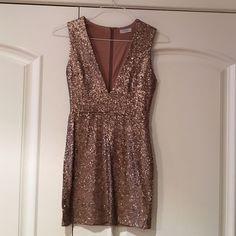 Tobi Sequin Dress Beautiful dress from Tobi, only worn once. Low cut and short, perfect if you want something that stands out. Great condition. Tobi Dresses Mini