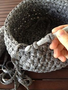 Lady Crochet. The snakeskin-like pattern on this kinda gives me the heebie-jeebies, but the effect is awesome. Her blog has a lot of cool ideas for baskets, rugs, wreaths and more (in Spanish– google translate)