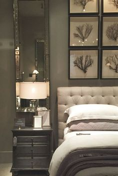 A fantastic solution for the space above a bedside table - a custom framed mirror. Add style without weighing down the space, and reflect the bedside lamp's light at the same time. Brilliant!