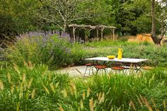 Set up a dining table. Add a dining table and chairs to your backyard to encourage your family to dine al fresco. contemporary landscape by Oehme, van Sweden Landscape Architecture The Secret Garden, Secret Gardens, Landscape Architecture, Landscape Design, Garden Design, Cheap Patio Pavers, Backyard Pavers, Hampton Garden, Rustic Pergola