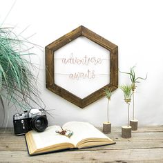 Is it a print? Is it hand-lettered? Is it engraved? Nope! Each quote, each word, each letter is hand-shaped from wire and framed with a rustic reclaimed wood frame. Whether you're looking to spruce up your home decor or searching for the perfect and most unique gift, these framed wire