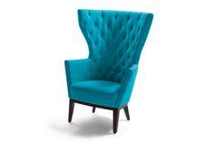 Der moderne Ohrensessel Lola von Signet. The modern wing chair Lola from Signet.