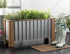 Similar corrugated metal planter on deck.