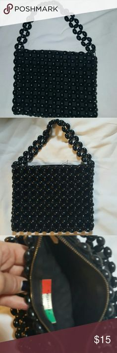 Vintage 70's black bead bag Time to let go of some vintage Treasures. Wonderful vintage condition. One flaw as shown in last photo. I can even take that back on. Very clean inside 7 inches across and 6 up and down. Price firm Vintage Bags Mini Bags