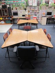 Good configurations for trapezoid tables; pictures are near the bottom of the pa Classroom Desk, Classroom Layout, Classroom Furniture, First Grade Classroom, School Classroom, Classroom Organization, Future Classroom, Classroom Table Arrangement, Desk Arrangements