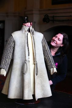 Julie Hawthorn with the buff coat worn by Sir Jacob Astley during the English Civil War