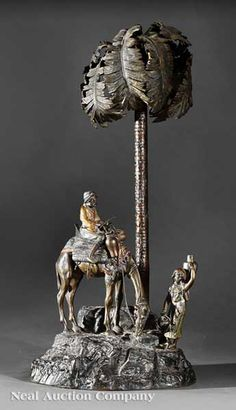 A Continental Orientalist Patinated and Polychromed Bronze Lamp