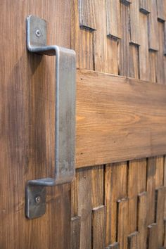 The patina on this sliding barn door hardware makes it look like it's been in use forever! | Artisan Hardware