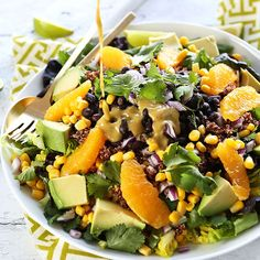 An easy, 30-minute mixed Mexican salad with quinoa, corn, black beans, avocado, and a creamy orange, lime, and chili dressing! Healthy, delicious and so satisfying.