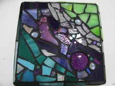 """OOAK Stained Glass Mosaic Art Wall Plaque """"The Infinite Cosmos"""" - 6.75"""" x """"6.75"""" Mixed Media Upcycled. Finished product, ready to ship! This mosaic has got some really gorgeous colors that can't be appreciated through a photo. Colors are much more vivid in person! Made with upcycled stained glass discards from working glass studios. We at PrancyBearStudio like to help better the environment by making beautiful art from someone else's trash. Made with glittered cabochons, hematite star…"""