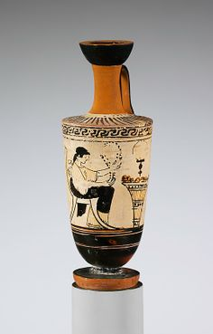 Terracotta lekythos (oil flask) Attributed to the Icarus Painter Period: Classical Date: 2nd quarter of 5th century B.C. Culture: Greek, Attic Medium: Terracotta; red-figure, white-ground Woman seated before kalathos (wool basket) The painter here has carefully rendered the wool filling the kalathos. A mirror hangs above.