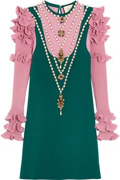Ornate embellishments were seen throughout Gucci's maximalist Fall '16 runway show – this mini dress is one of our favorite looks. Knitted from a sumptuous wool-blend, this teal and lavender dress has ruffled sleeves and is adorned with faux pearls, beads and crystals to look like layered necklaces. Wear yours with bare legs and flats.