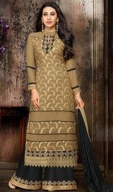 Karisma Kapoor Beige Color Georgette Palazzo Suit #bollywoodsuitsonline #bollywooddesignerdresses2017 Keep ahead in style with this Karisma Kapoor beige color georgette palazzo suit. The interesting lace, patch and resham work through the attire is awe-inspiring.  USD $ 73 (Around £ 50 & Euro 55)