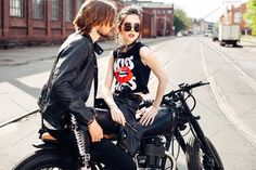 young couple sitting on vintage motorcycle by johan_k on @creativemarket