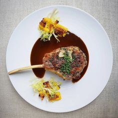Herbed Veal Chop in Madeira Sauce with charred garlic corn and frisée Meat Recipes, Gourmet Recipes, Cooking Recipes, Veal Chop, Food Plating Techniques, Bistro Food, Le Diner, Gastronomia, Modern Kitchens