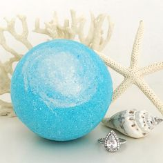 Pearl Bath Bombs Sea Goddess Ring Bath Bomb With swirls of ocean blues and shimmering pearl dust, this bath bomb will turn your tub into a spa fit for a goddess. A fresh and intriguing blend of agave, sea kelp, ocean breeze and soothing sandalwood will relax your body, mind, and inner mermaid.