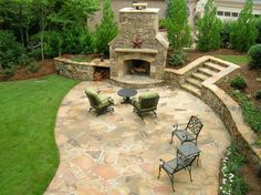 outdoor fireplace with stone patio