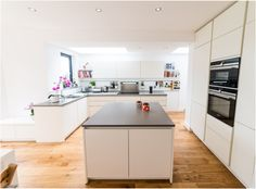 A white matt handleless German kitchen in Alexandra Park, London. The worktop is Silestone and the appliances are Siemens. One of our recent projects. Alexandra Park, Handleless Kitchen, German Kitchen, White Kitchen Island, Table, K2, Holland, Furniture, Kitchens