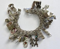 Heavy Lang Sterling Charm Bracelet Loaded with Charms 23 Charms 12 Sterling 11 unmarked State Symbols., Hawaii, Tikis, Surfer 7 long wide woven Lang Chain Bracelet has safety chain g Heart Jewelry, Wire Jewelry, Antique Jewelry, Silver Jewelry, Vintage Jewelry, Jewlery, Vintage Charm Bracelet, Sterling Silver Charm Bracelet, Silver Charms