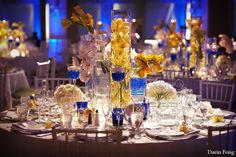 Got the blues for yellow in this romantic table top decor for an indoor wedding