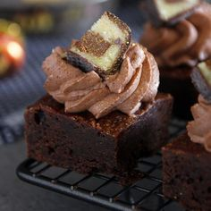 Mozart Brownies - gluten free almond brownies topped with chocolate praline whipped cream, Mozart and edible gold dust