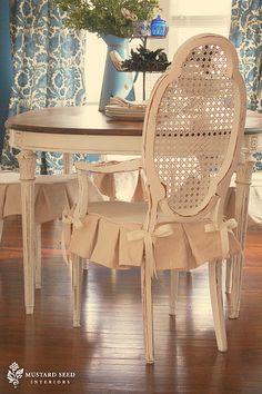 Old stained French Provincial dining room suite reborn with paint, fabric, & creativity.