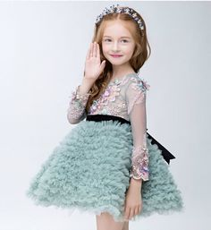 Grass Green Embroidery Dress-Puffy Green Embroidery Flower Applique Long Sleeve Sheer Neckline Flower Girl Dress Perfect for Birthday, Wedding or any special day. Available from 3 until 12 years old  Material: Organza, polyester fiber, cotton, tulle mesh Please do compare your  little girl measurements with our size chart below before deciding her size