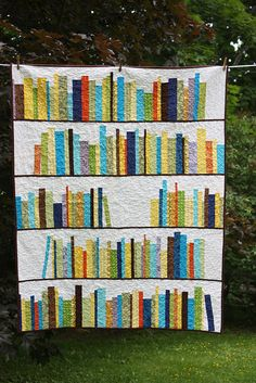 A bookshelf quilt! You could embroider the names of your favorite books on them. Would be a great hand-me-down for your children (the books would tell them a bit about you).