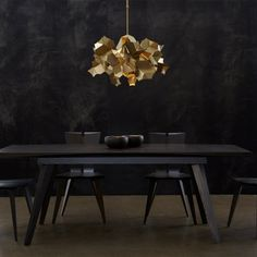The cumulus pendant features 18 cut and folded plates of steel that filter and redirect the central light. Each leaf-like plate is articulated and can flutter at a touch. Adjustable pendant with decorative steel shade.