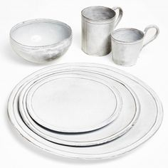 Astier de Villatte Simple Dinnerware  Sweet simplicity. Handmade on the Rue St. Honoré in Paris, the Simple ceramics have gracefully sloping silhouettes and a simple, classic aesthetic.