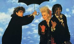 Thompson Twins.  Great band!  Lots of great songs, but two favorites are King for a Day and Long Goodbye.