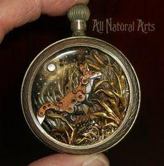 Bellissime sculture con ingranaggi di orologi a taschino in miniatura