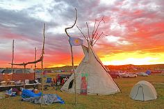 A traditional Sioux teepee at sunrise in the overflow Sacred Stone Camp at Cannon Ball, North Dakota: Walter Simon