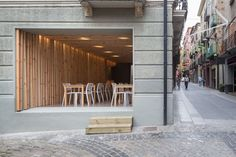 conceived as a indoor pergola, wooden insertions seek to provide a stark visual contrast with the...