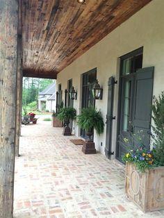 Traditional Porch with Wrap around porch, exterior brick floors Love the brick flooring Exterior House Colors, Exterior Paint, Exterior Design, Exterior Shutters, White Wash Brick Exterior, Black Shutters, Black Doors, Brick Exterior Makeover, Stucco And Stone Exterior