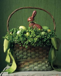 Clover Basket | Martha Stewart Living - This fanciful green-meadow vignette seems a fitting home for a chocolate bunny. His eyes (dabs of tinted royal icing) and bow tie (ribbon with a glued-on rosette) match his surroundings.