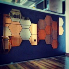 Honefoss mirrors on a dark wall.