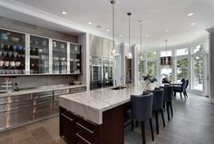Contemporary Kitchen with Restoration hardware rhys smoke glass prism round chandelier, Glass panel, Complex marble counters