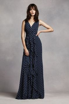 This dress is so figure flattering that you will try to find more occasions to wear it!  Long V-neck wrapped bodice gown of polka dot chiffon features front vertical bias cut ruffles on skirt and a self-tying sash.  Sizes 0-26.  Fully lined. Back zipper. Imported.  Dry clean only.